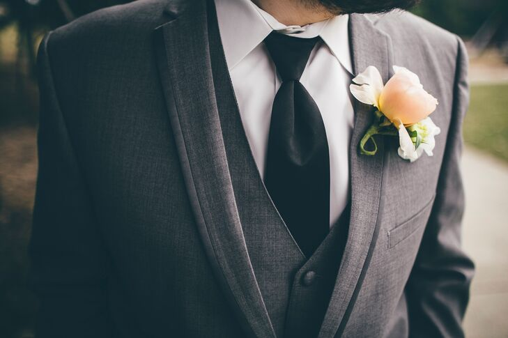 The groom wore a single rose pinned to his classic gray suit for a look that was formal, yet relaxed.