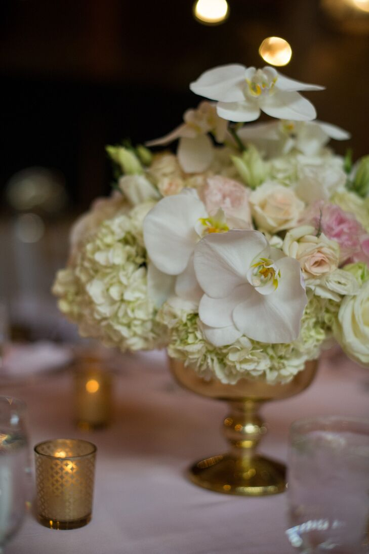 Low White and Pink Centerpieces of Stephanotis, Hydrangeas and Roses