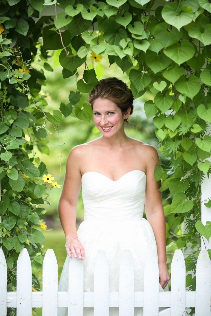 Caitlin wore a classic A-Line gown with an embroidered skirt and ruched sweetheart bodice.