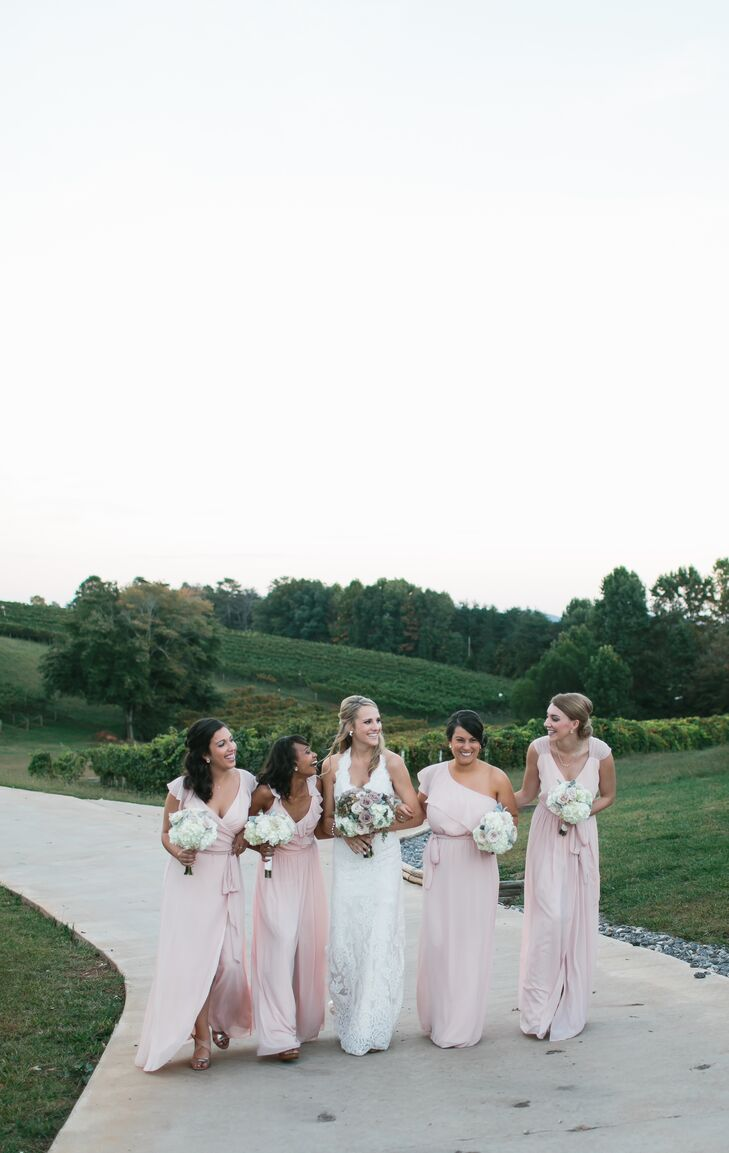 Liza's bridesmaids wore different style blush wrap dresses from Bella Bridesmaids.