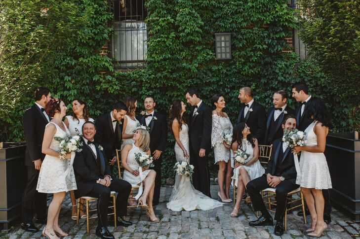 """Nancy and Michael were drawn to the Green Room for its lush ivy-covered wall and illuminating full-ceiling skylight. """"The space was so beautiful that we did not want to change much, only enhance it with greenery and white flowers and candles."""""""
