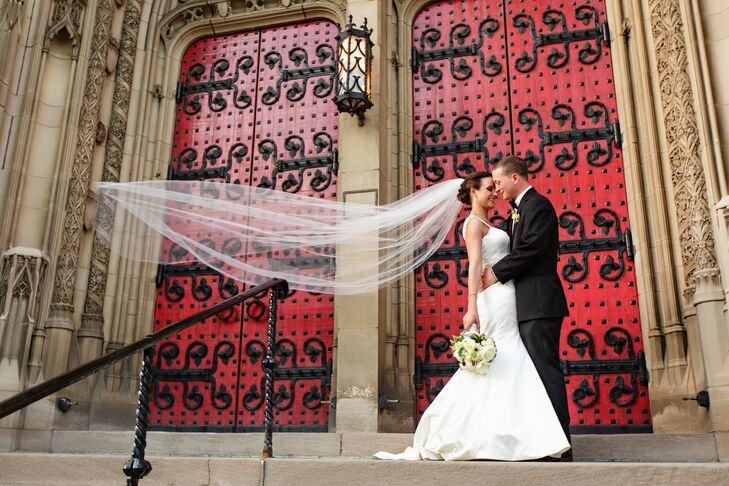 The newlyweds celebrate outside the red doors of the Heinz Chapel on the University of Pittsburgh's campus.