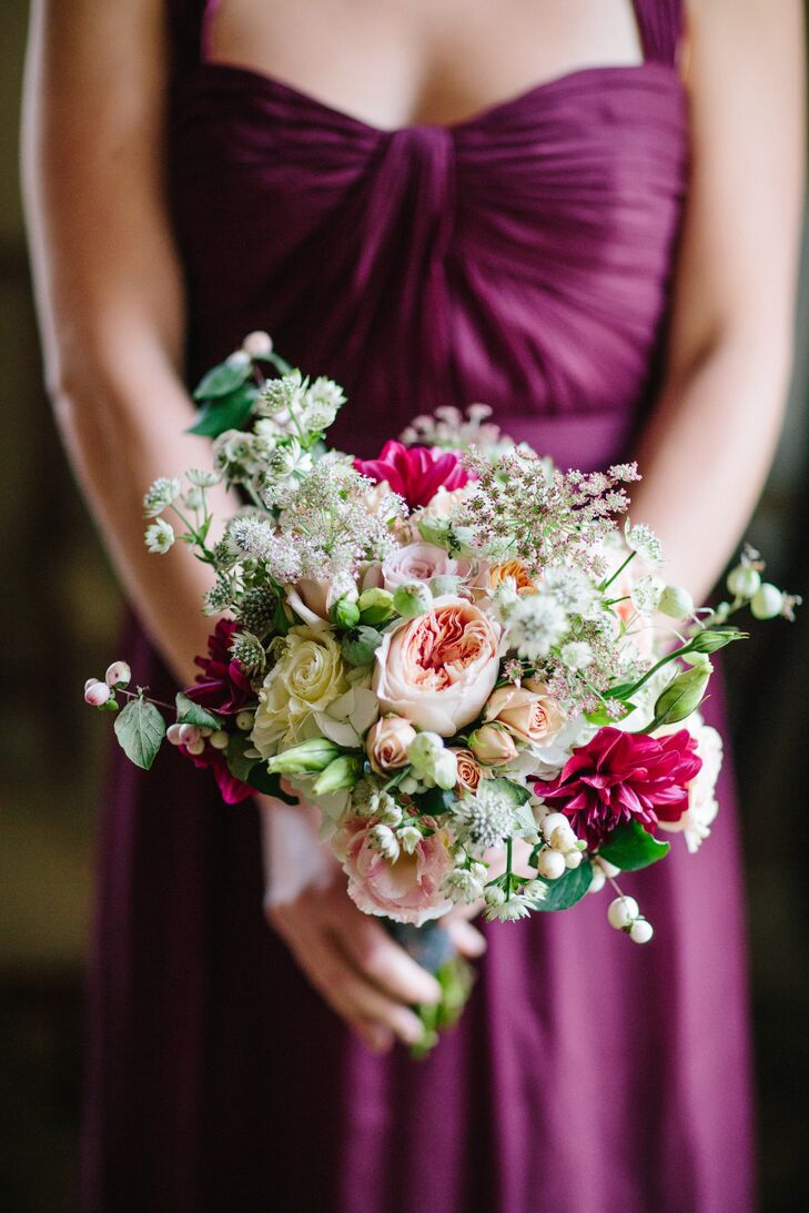 The bridesmaid bouquets from Stone Floral were a lively medley of baby's breath, greenery and crimson, which paired beautifully with the deep crimson Amsale bridesmaid gowns.