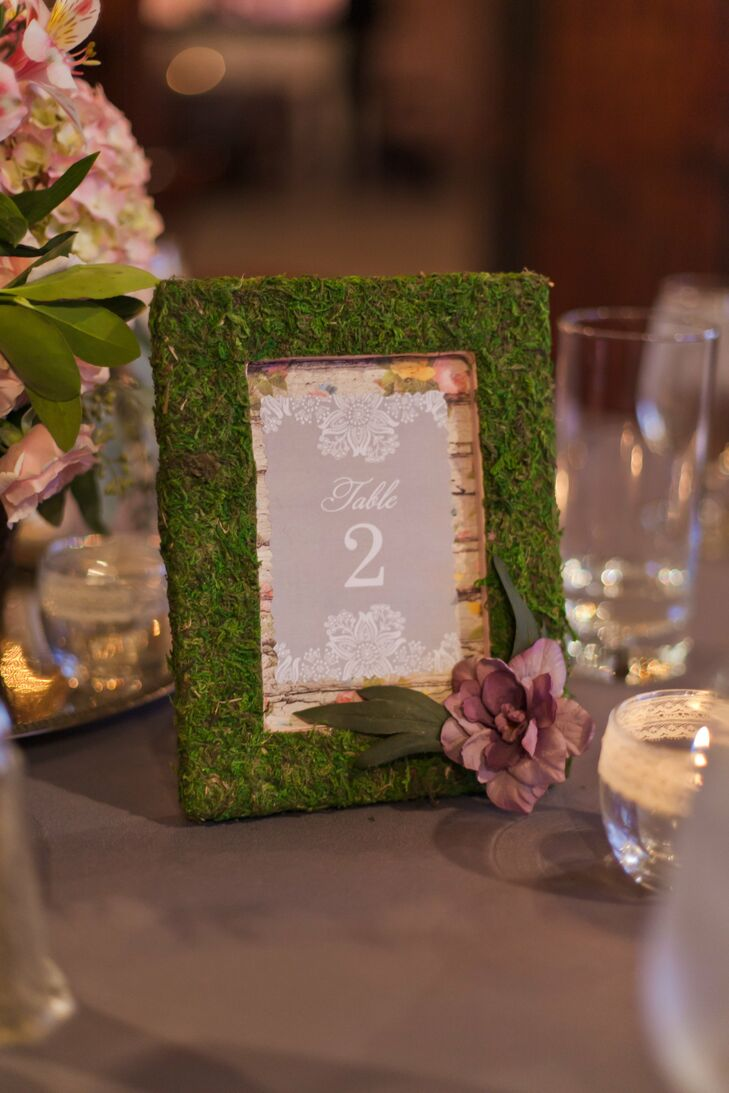 Kristen made the table numbers, which were moss covered picture frames with a different lace, flower or key decoration on them.