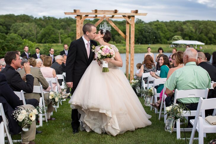 Haley and Michael exchanged vows on Haley's family's farm in Festus, Missouri. They decorated the stunning outdoor ceremony space with a hand-built wooden arbor made from a cedar tree that one of their friends even cut down for them. A crystal chandelier and timeless white flowers added an elegant vibe to the otherwise rustic space.