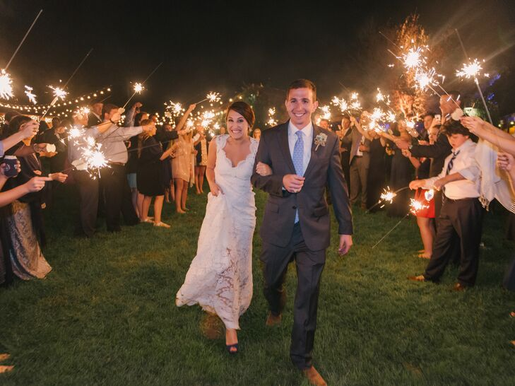 In addition to the traditional wedding festivities like the dance floor, guests enjoyed a s'mores bar, a campfire and a coffee bar to keep them cozy once the sun went down. They were also given shawls, koozies and custom sunglasses as favors.