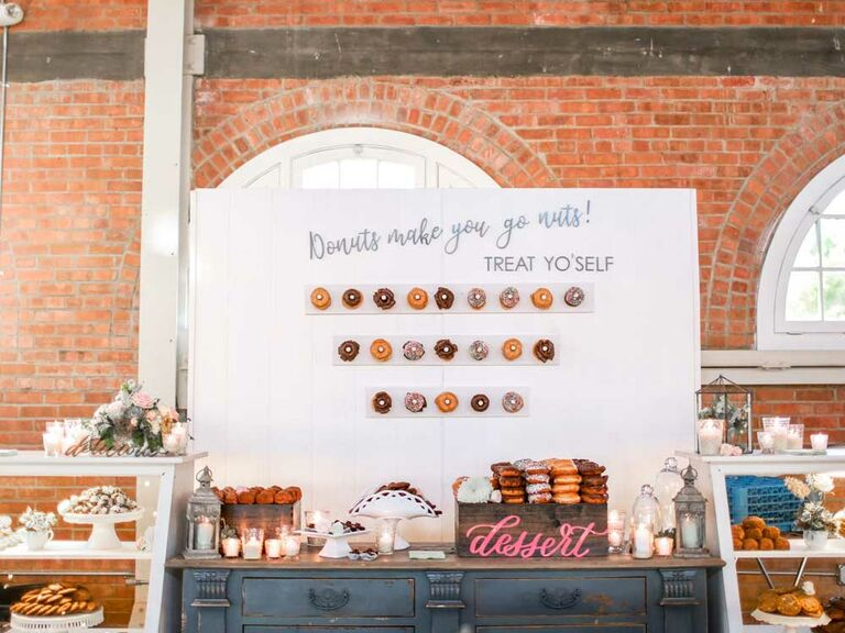 Large donut wall with dessert spread