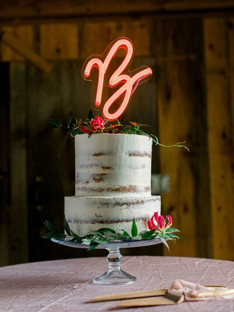 Small wedding cake with neon light up cake topper