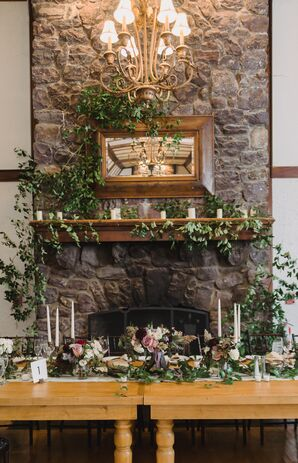 Bohemian Sweetheart Table with Draped Greenery on Vintage Fireplace