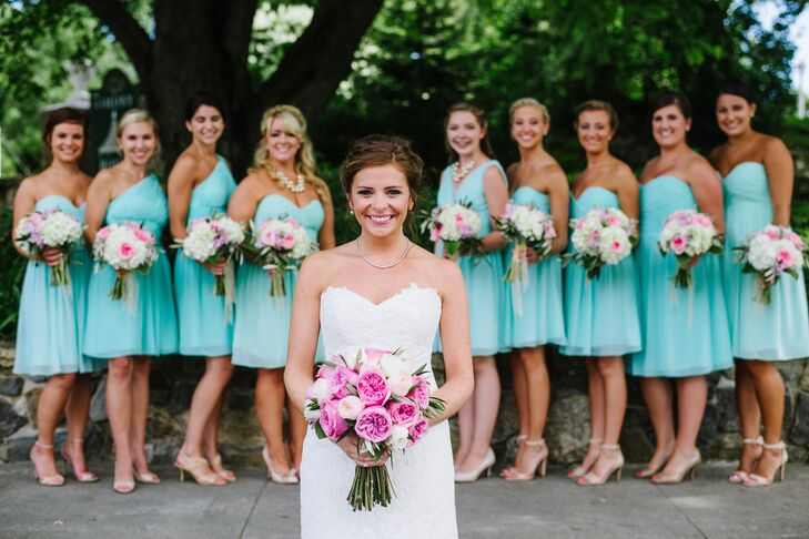 The bridesmaids wore Donna Morgan mint colored strapless cocktail dresses.