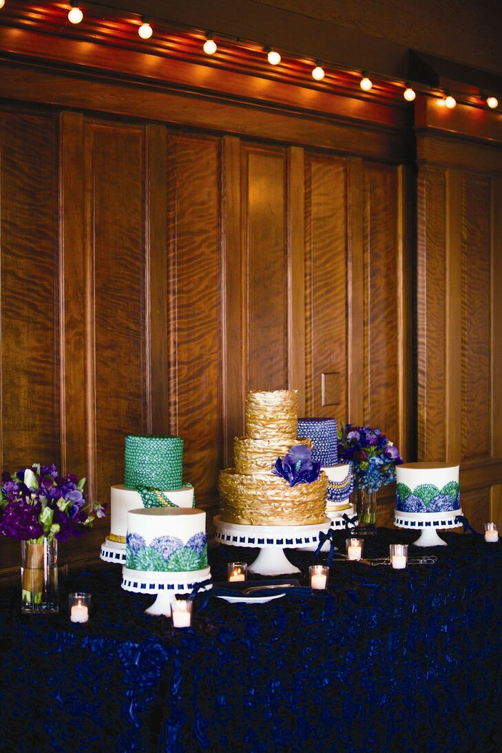 Jennifer and Eric had a hard time deciding on a wedding cake flavor, so they chose to have multiple confections! Their cake table featured five different cakes, decorated in the deep jewel tones of the day.