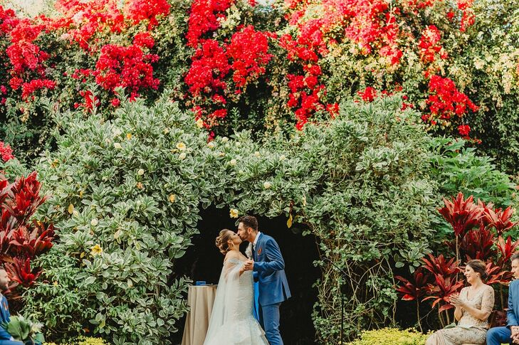 "Sarah Nadler and Brent Gallas jokingly refer to their wedding style as ""wildlife explorer glam.""  They based the day around their shared love of anima"