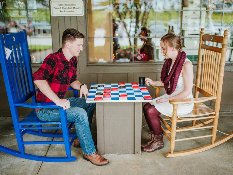 couple takes engagement photos at Cracker Barrel