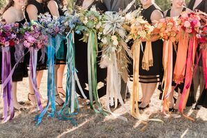 Rainbow-Hued Wedding Party Bouquets at Blue Vista in Randolph, Kansas