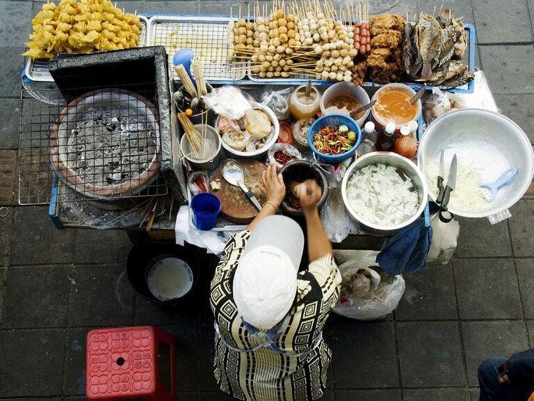 Thailand, Bangkok, aerial view of a street food stall vendor prepping food