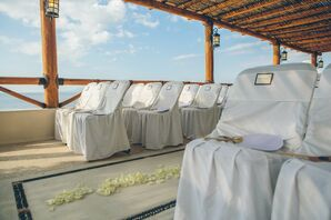 Ivory Linen-Covered Waterfront Ceremony Chairs