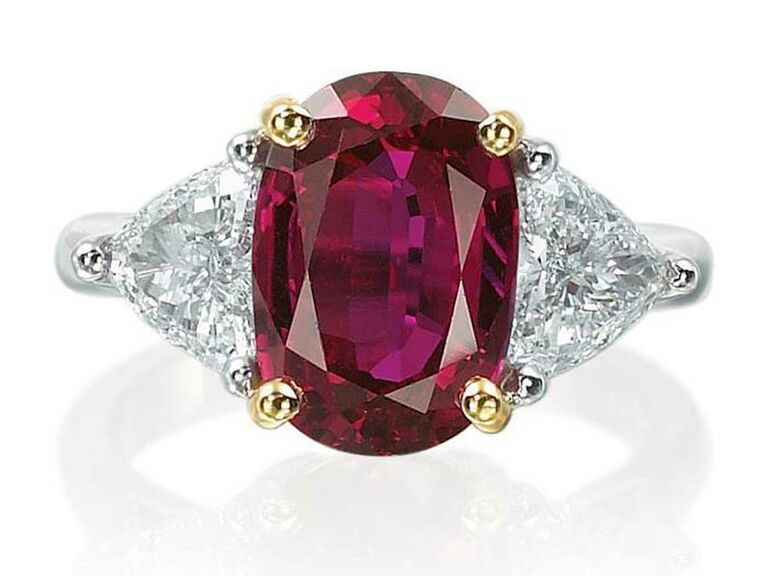 Oval ruby engagement ring with large diamond side stones