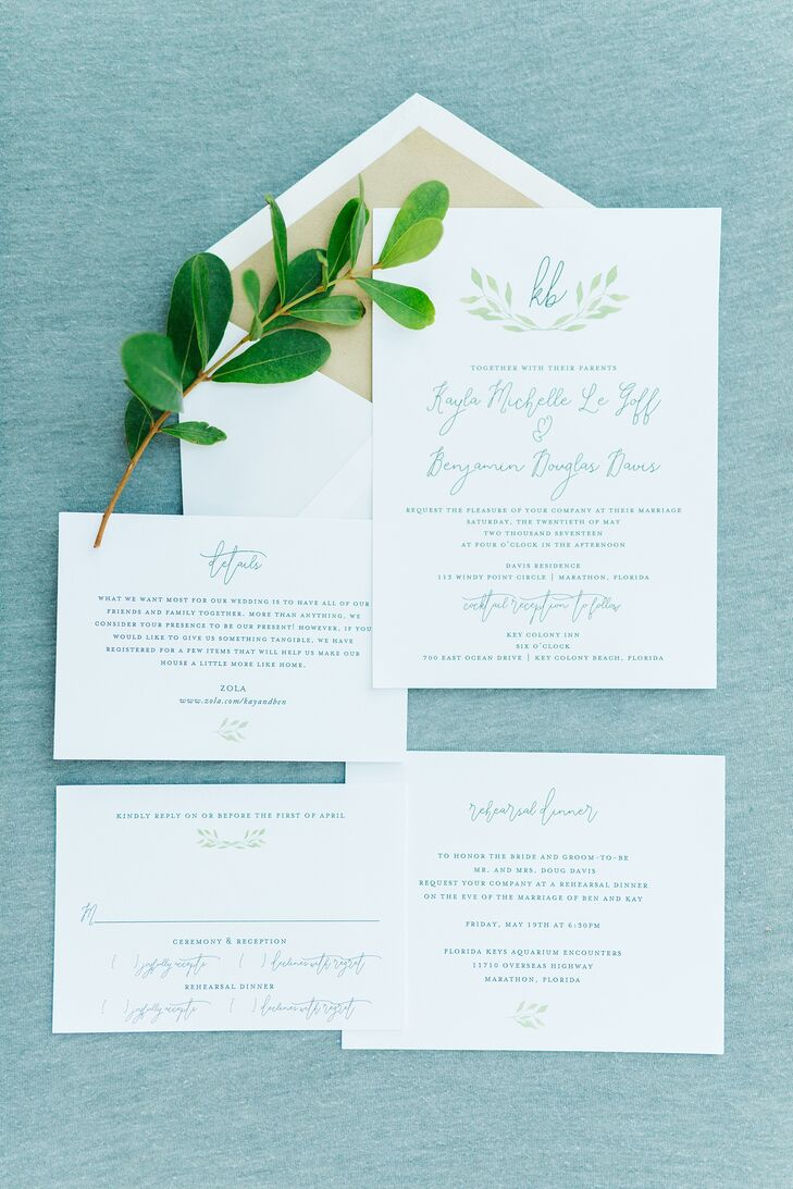 White invitations with greenery embellishments set the tone for Kay and Ben's chic white-and-green oceanside nuptials at Ben's parents' home in Marathon, Florida.