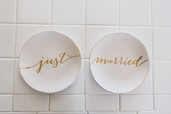 """The couple had two white elegant dishes that read """"Just Married"""" in gold cursive."""