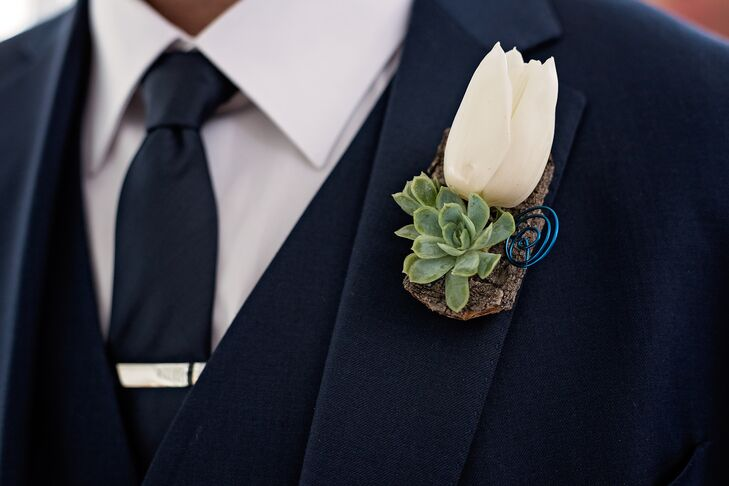 A white tulip was paired with green succulents for the simple, sophisticated boutonnieres designed by Laurel's On Whyte.