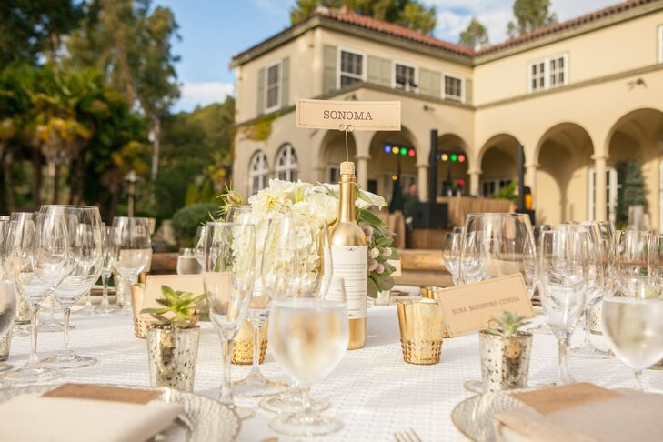 At the outdoor reception at Chateau St. Jean Winery in Kenwood, California, a combination of round and farm tables were topped with crisp white linens and gold mercury-glass vases.