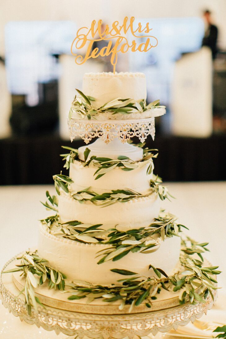 "Lauren's aunt baked the four-tier wedding cake, decorated in olive leaves and surrounded by flower-filled coffee mugs spelling out ""amore"" in gold letters. ""My aunt's cake is, by far, the best cake I've ever had,"" Lauren says."