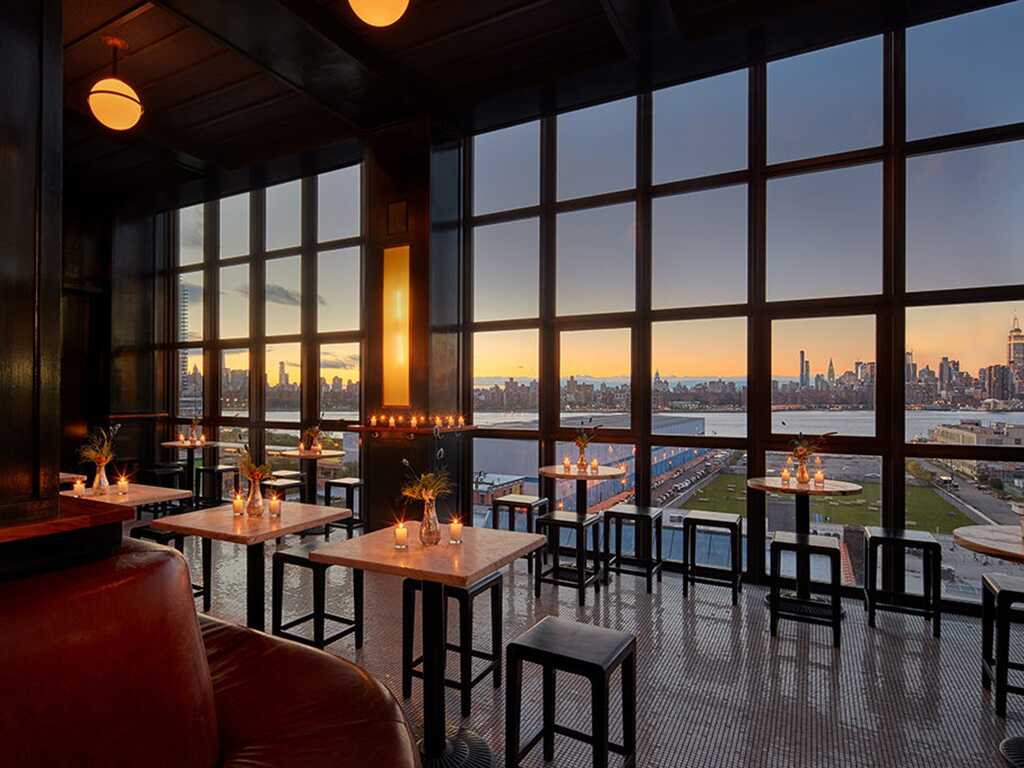 Ambient nighttime view of Wythe hotel and sunset over the city.