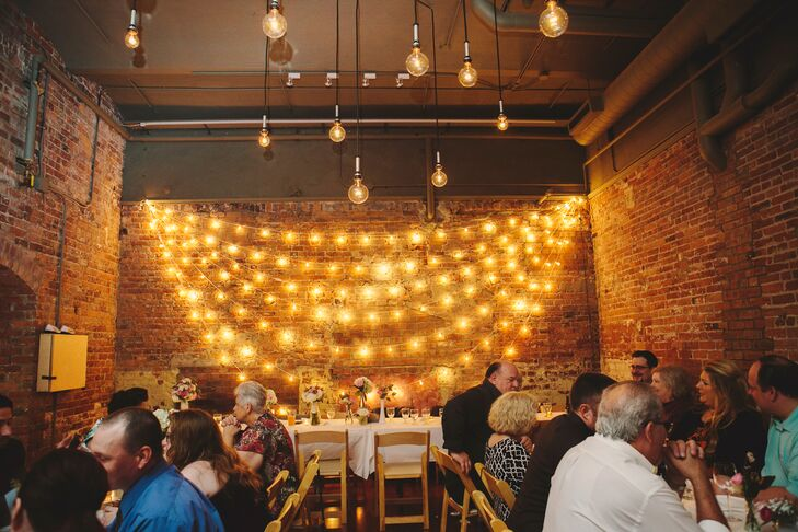 """The cozy, Ann Arbor venue featured brick walls, distressed wood floor and string lights. """"It was exactly what we were looking for,"""" Alex says. """"Cozy, intimate and filled with tons of charm."""""""