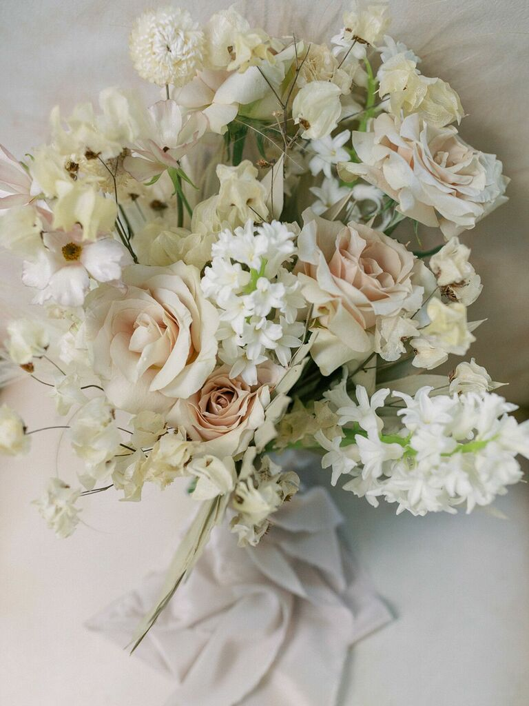 Neutral wedding bouquet with tan roses