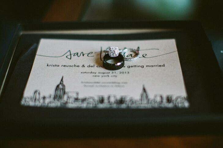 Krista's wedding band matched her platinum, cushion cut ring with a diamond halo. Del chose a black titanium band.