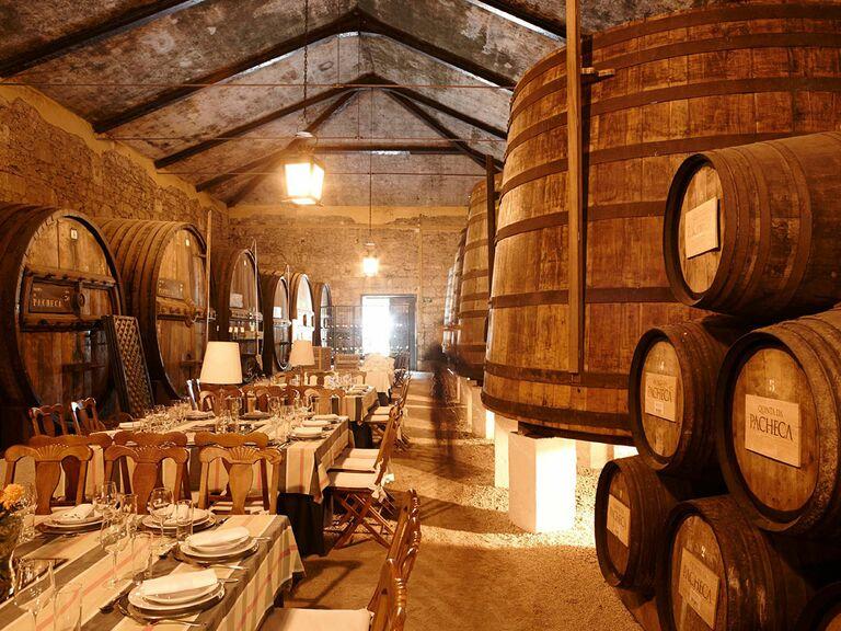 Wine barrels surround the dining hall at Quinta da Pacheca