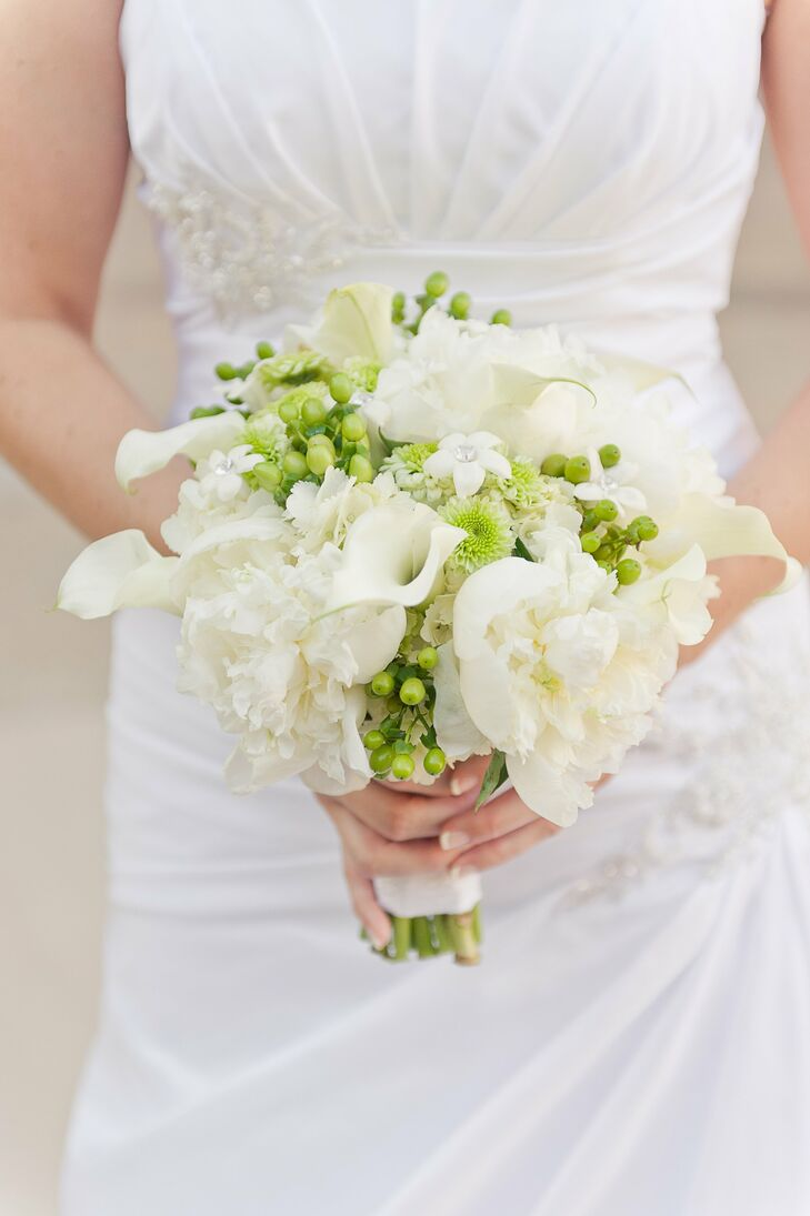 The bride carried a bouquet of white and green flowers textured with hypernicum berries.