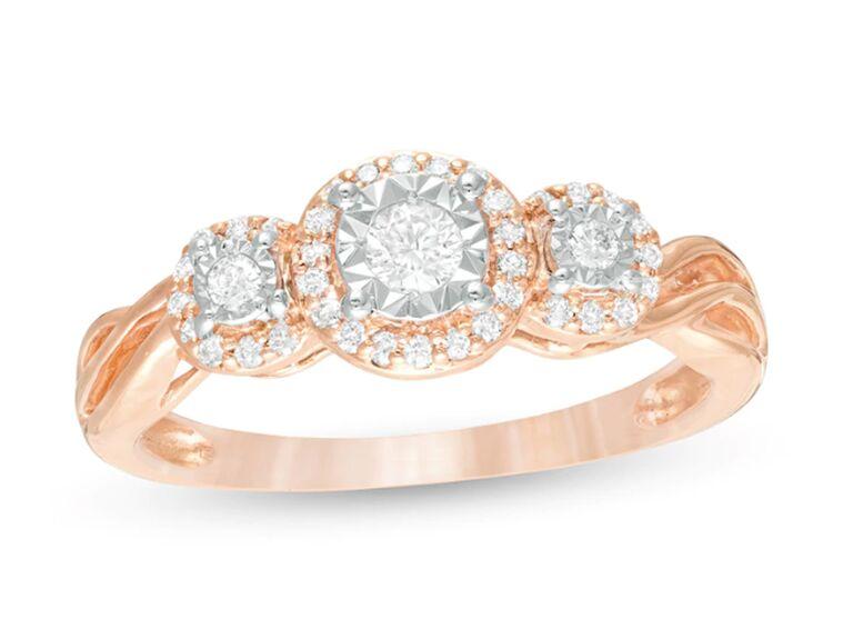 Three stone diamond engagement ring in rose gold