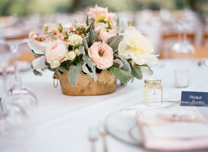 The centerpieces included roses, peonies and hypericum berries for simple, but lush floral arrangements.