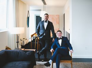 Andrew Ford (35 and a lawyer) and Jonathan Escalante (25 and self-employed) maroon, navy and gold palette paired with branch centerpieces and marble a