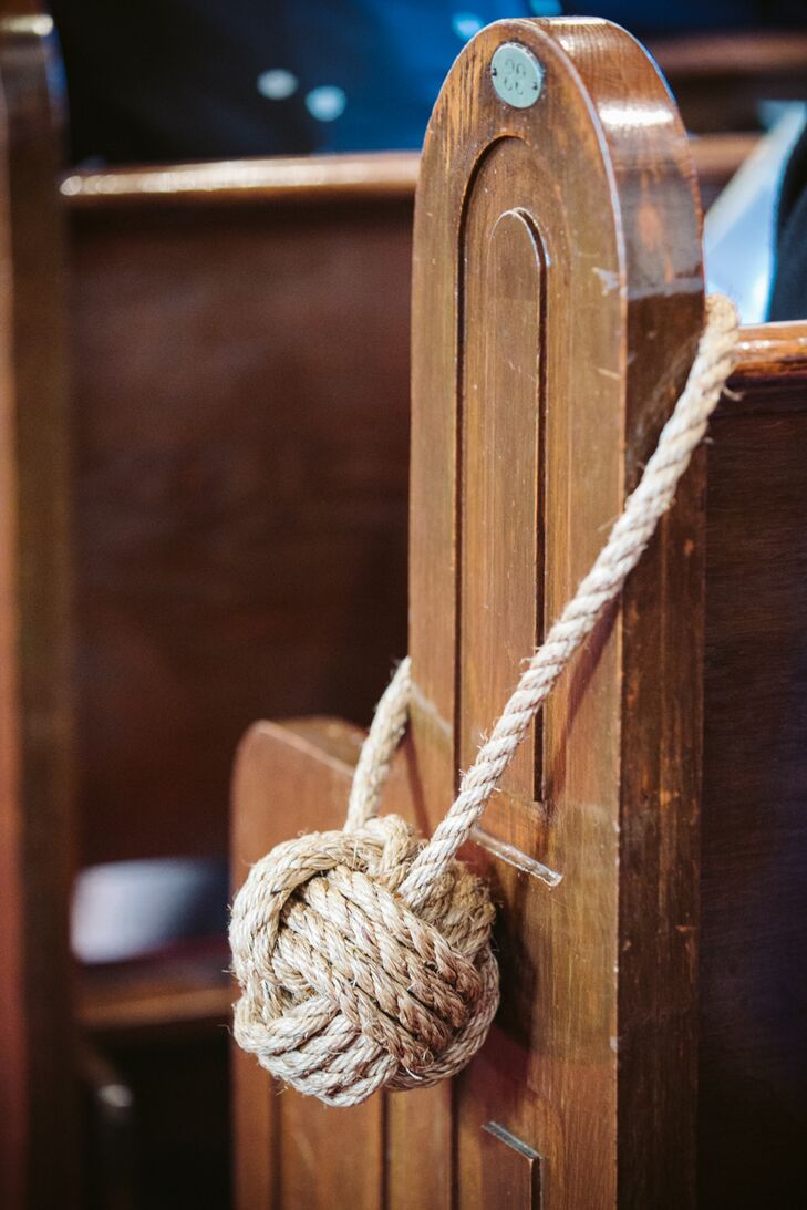 Before heading to East Hampton Point for a waterfront reception, Jill and Conor exchanged vows in a traditional church ceremony. To give guests a taste of what was to come, the couple gave the church the nautical touch, decorating the church pews lining the aisle with natural rope monkey's fists.