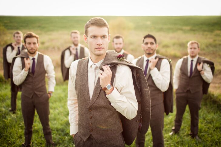 Craig and his groomsmen pose like professionals in their neutral-colored suits. The texture of the fabric perfectly ties into the rustic, burlap accents in the wedding decor.
