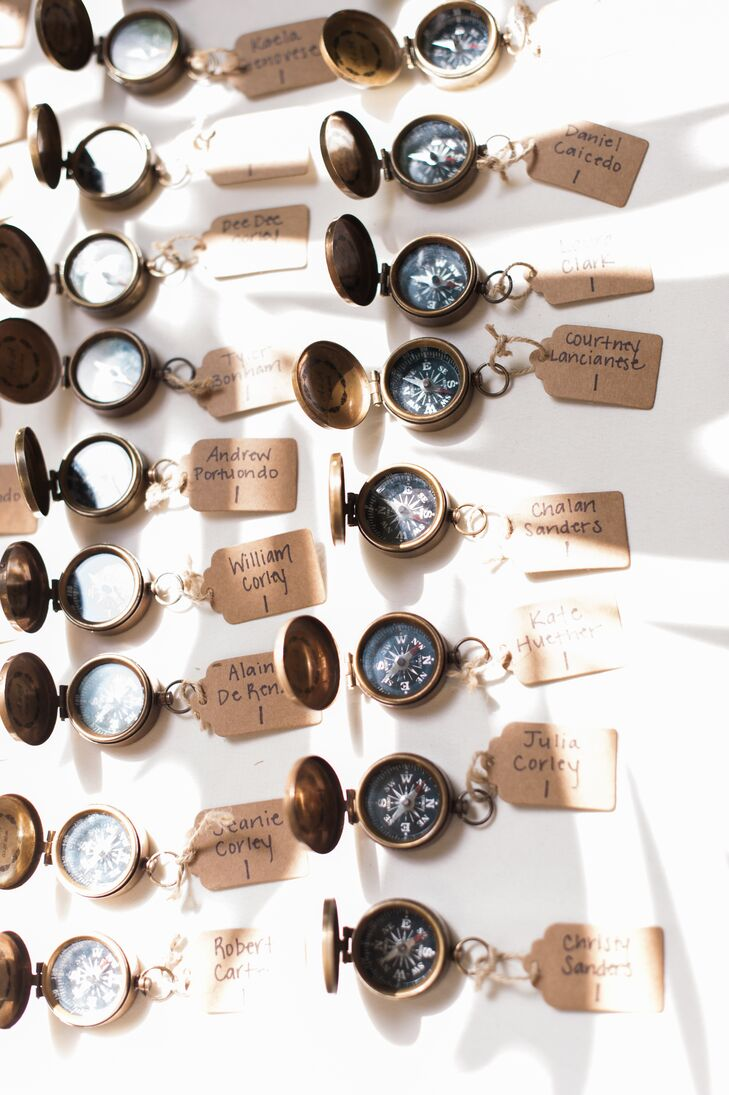 To help find the way to their seats, guests picked up the brass compass with their name attached. These dual-purpose favors spoke to the couple's love of adventure and travel.