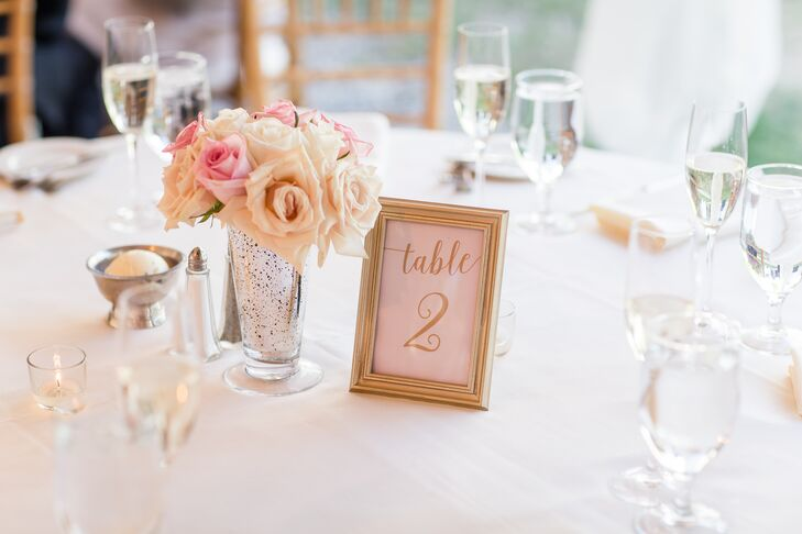 Justina and Christopher kept things simple when it came to the decor, not wanting to take away from their beautiful venue, Searles Castle in Windham, New Hampshire. The couple decorated the space in a spectrum of soft hues, like champagne, blush, ivory and pink, keeping the floral arrangements understated yet romantic, with classic roses displayed in mercury glass vases.