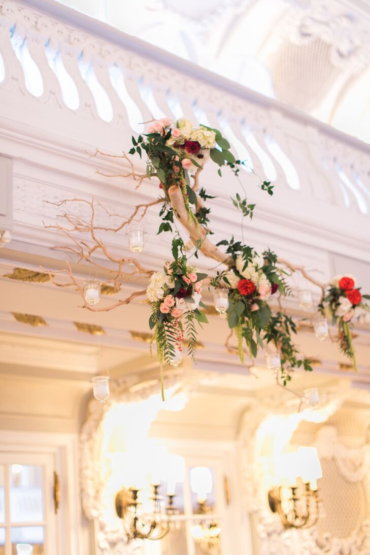 A birch branch with arrangements of rose sand eucalyptus leaves hung above the guests in the gorgeous, bright reception space.
