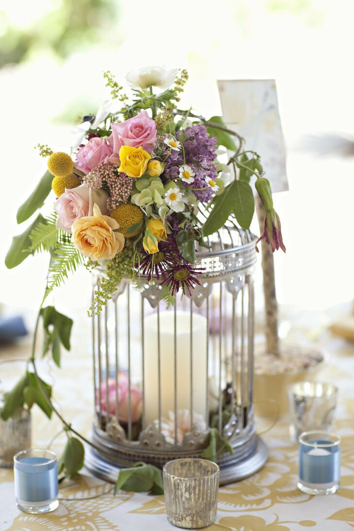 The centerpieces were a mix of flowers and birdcages--half of the tables had birdcages with flowers attached and candles inside while the other half of the tables had potted flowers surrounded by candles.