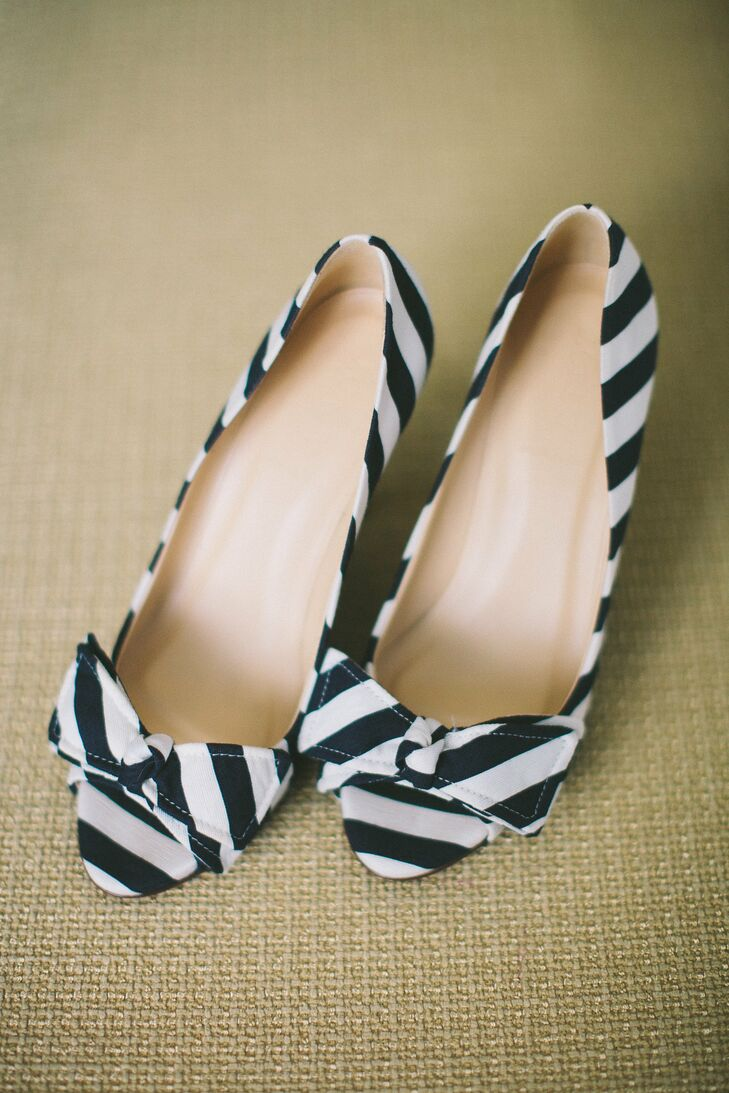 Emily wore a bold pair of striped peep-toe heels.