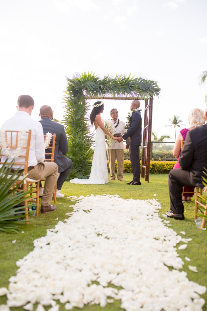 Bethany and Leonard's intimate oceanview ceremony for 20 guests took place in the Plumeria Garden at the Four Seasons Resort Maui in Wailea, Hawaii. The aisle was strewn with white petals.