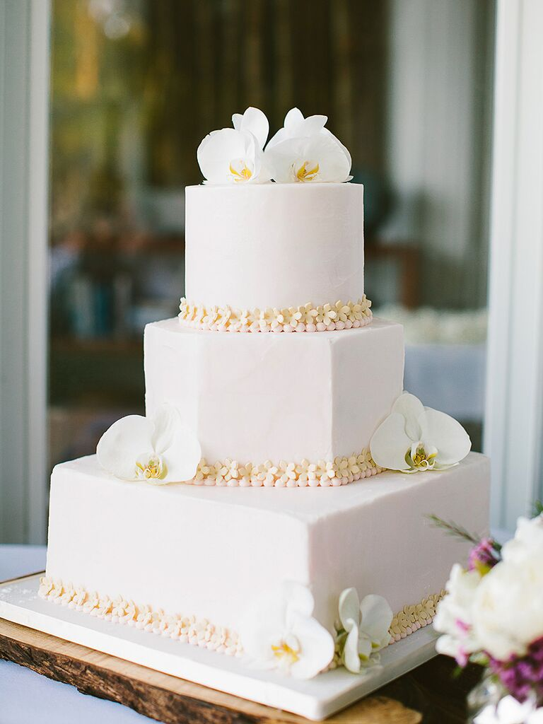 Modern white wedding cake with orchids
