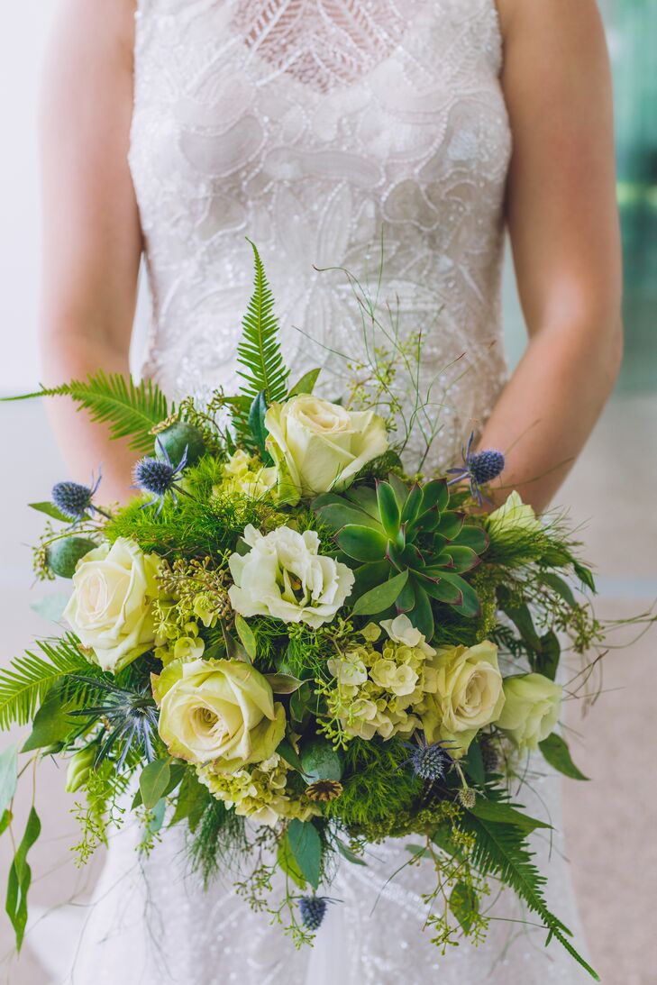 Stephanie's mostly green bouquet featured lush foliage, roses, succulents, berries and thistle.