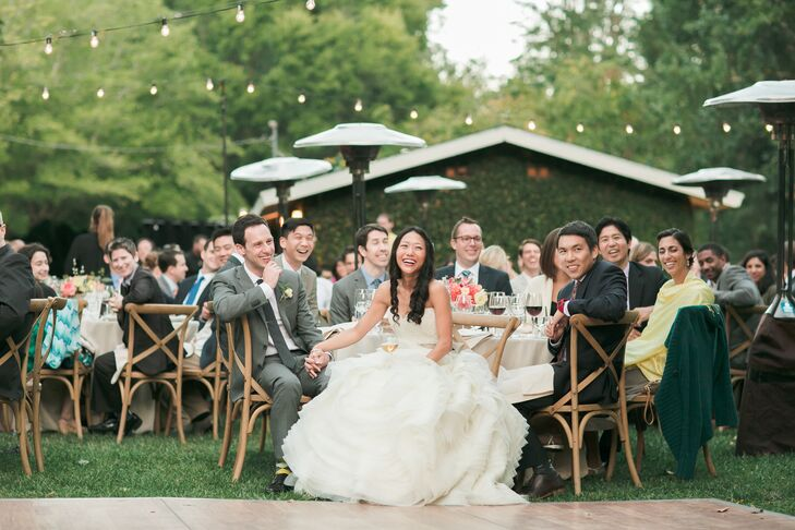 Jared sported a gray Banana Republic suit, which he paired with a matching tie. He sat at his table for the reception next to Deborah, who wore her elegant Lazaro dress accented with lace on the bodice.
