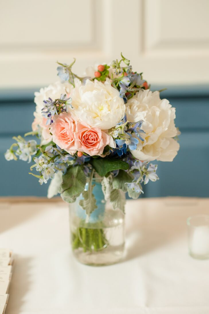 Mason Jars Filled With White Peonies Pink Roses Blue Flowers Red Hyperi And