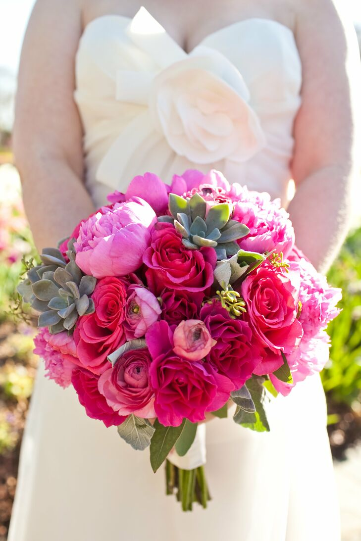Michelle loved the natural texture of the bright-pink roses, succulents and ranunculus in her bouquet.