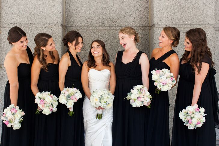 The bridesmaids looked refined in black luxe chiffon convertible dresses by Jenny Yoo.