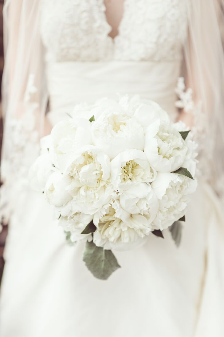 Meg carried a crisp, clean, spring bouquet made from white peonies.